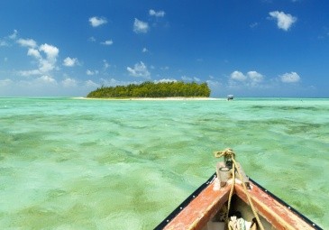 Mauritius, Rodrigues Island, Pointe Mangue, horizontal view of a deserted island in the middle of a lagoon turquoise waters from a boat